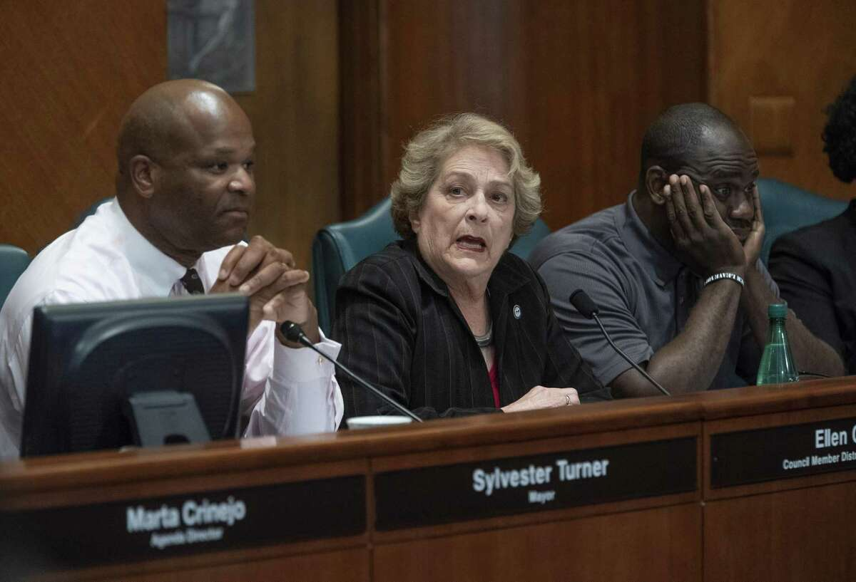 """Mayor Pro-Tem Ellen Cohen (center) announces that she will not be staying to hear an appearance by Houston Fire Department Chief Sam Pena at a Houston City Council ethics committee meeting Monday afternoon at City Hall stating that she believes the panel has """"nothing to do with ethics"""" before walking out, Monday, April 29, 2019. Councilman Dwight Boykins (left) and Jerry Davis (right) listen as Cohen speaks."""