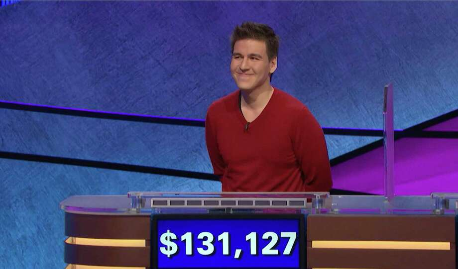 "This image made from video aired on ""Jeopardy!"" on Wednesday, April 17, 2019, and provided by Jeopardy Productions, Inc. shows James Holzhauer. The professional sports gambler from Las Vegas Holzhauer won $131,127 during a show that aired Wednesday night, breaking the record that viewers saw him set last week. Click through the gallery for a look at ""Jeopardy!"" questions. / Jeopardy Productions, Inc."