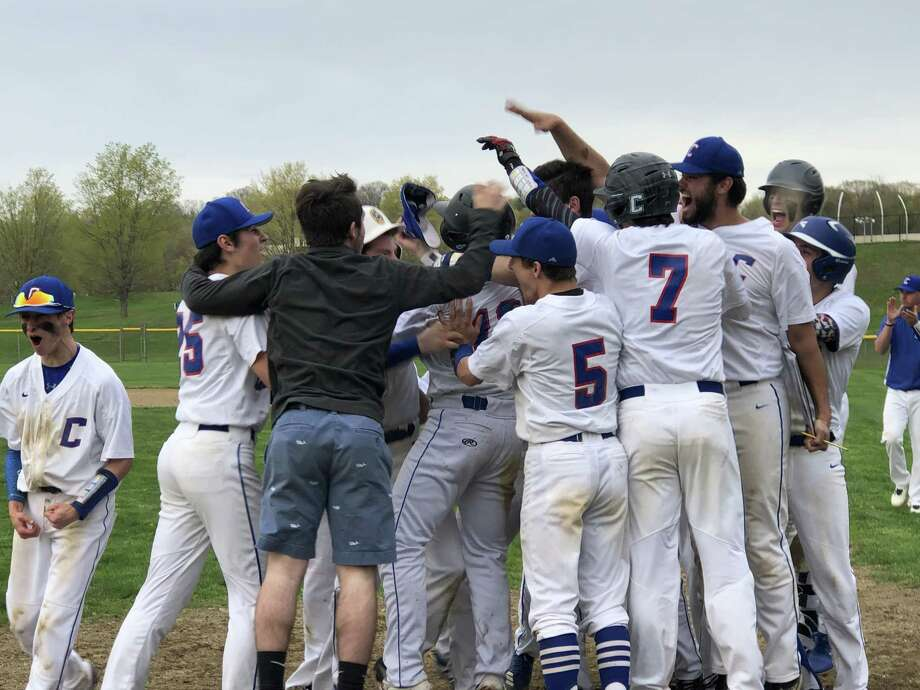 Coginchaug players meet Connor Rulnick at home plate after his two-run home run gave the Blue Devils an 8-6 win over Haddam-Killingworth on Monday, April 29, 2019. Photo: Paul Augeri / For Hearst Connecticut Media / Stamford Advocate Freelance