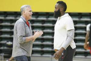 At Monday's Rockets practice at the University of San Francisco, coach Mike D'Antoni, left, conveyed that he wants James Harden and his teammates to shoot before the 24-second clock winds down to its third and fourth quadrants.
