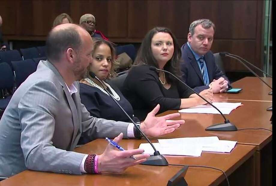 (From left) Marc Poulos, executive director of the Illinois-Indiana-Iowa Foundation for Fair Contracting; Charise Williams, director of external affairs at Chicago Federation of Labor; Alison Howlett, executive director of Chicago Laborers District Council Labor-Management Cooperation Committee; and Dave Comerford, legislative director of the Illinois Federation of Teachers, testify before the Illinois House Labor and Commerce Committee on Friday in Chicago. Photo: Credit: BlueRoomStream