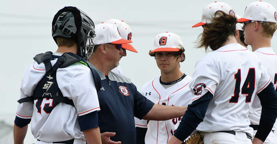 Bridgeland Head Coach Paul Orlando, center, makes a pitching change against Atascocita in the first inning of their matchup in the FBISD Varsity Tournament at Travis High School on March 9, 2019. Photo: Jerry Baker/Contributor