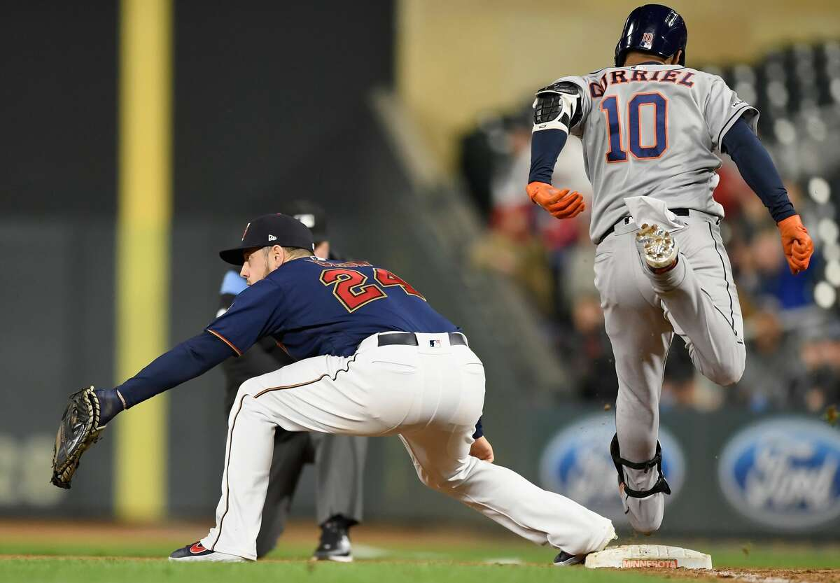 MINNEAPOLIS, MN - APRIL 29: Yuli Gurriel #10 of the Houston Astros is out at first base as C.J. Cron #24 of the Minnesota Twins fields the ball to complete a double play during the ninth inning of the game on April 29, 2019 at Target Field in Minneapolis, Minnesota. The Twins defeated the Astros 1-0. (Photo by Hannah Foslien/Getty Images)