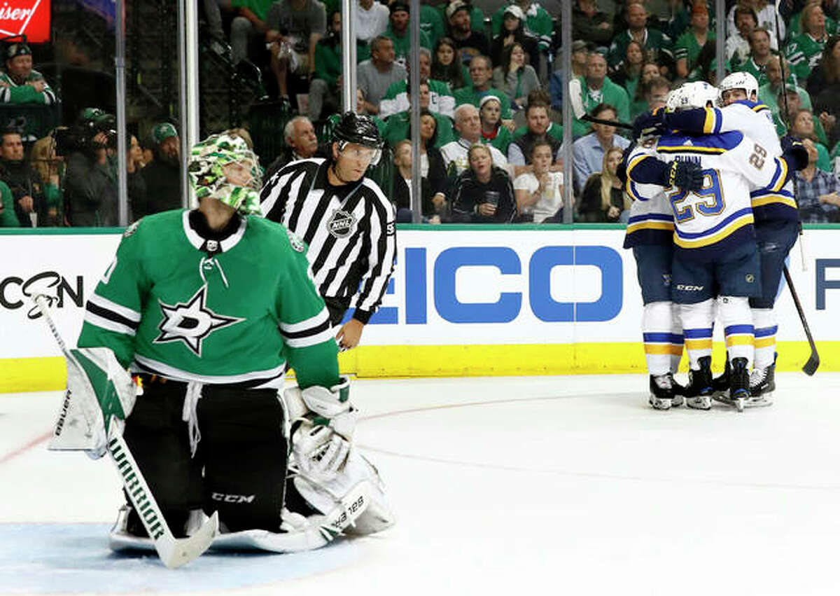 Dallas Stars goaltender Ben Bishop (30) reacts as the Blues' Robert Thomas (18), Tyler Bozak (21), Vince Dunn (29) and Pat Maroon, right rear, celebrate a goal by Bozak in the second period of Game 3 of their NHL second-round Stanley Cup Playoff series Monday in Dallas.