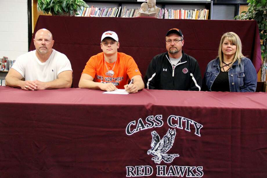 Cass City's Jarod Naegele recently signed his letter of intent to continue his football career at Ohio Northern. Pictured from left are Cass City football coach Scott Cuthrell, along with Naegele's parents Jeff and Jodi. Photo: Mike Gallagher/Huron Daily Tribune