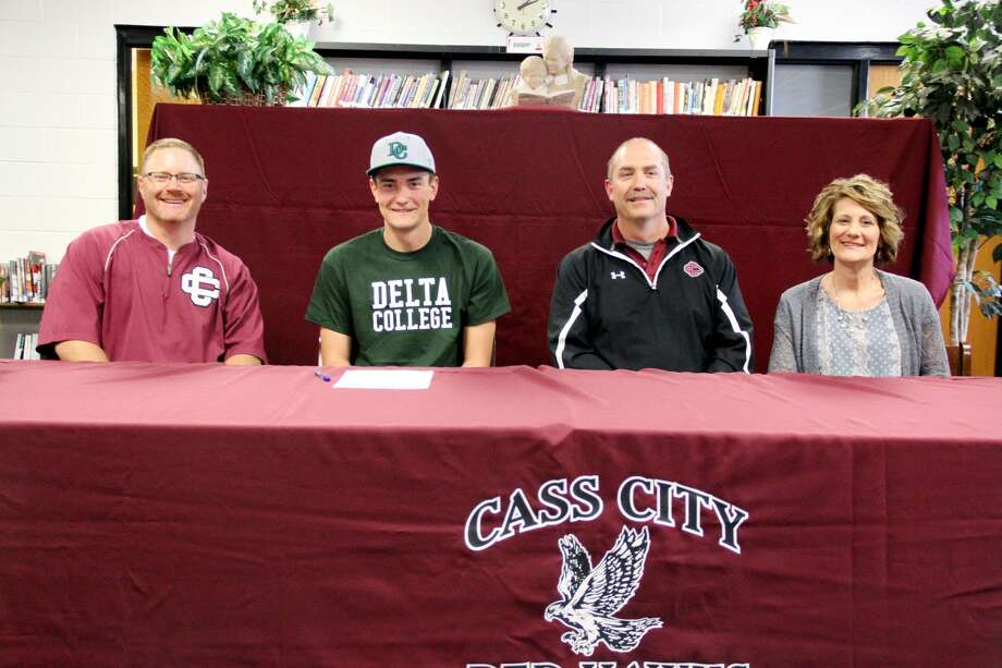 Cass City's Zack Beecher recently signed his letter of intent to continue his baseball career at Delta College. Pictured from left are Cass City baseball coach Josh Stern, along with Beecher's parents Leroy and Kellie.  Photo: Mike Gallagher/Huron Daily Tribune