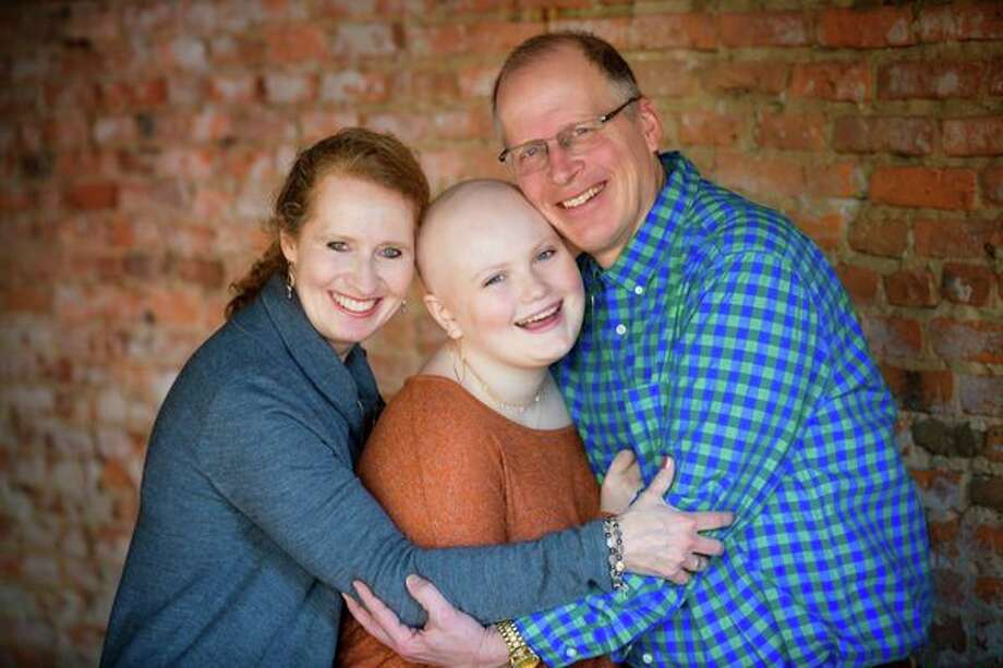 Ruth Pasek with her parents, Angelaand Dave Pasek, of Midland.(Photography provided/Fagan Studios)