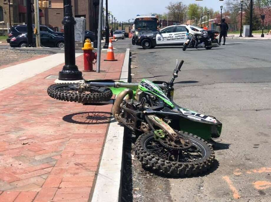 Hartford police officers working a private job jumped into action after they witnessed an illegal dirt bike driver strike a pedestrian in a construction site on Monday, April 29, 2019. The officers gave the victim medical aid while other officers chased Nathaniel Dejesus, 19, of Hartford, on foot, police said. Photo: Hartford Police Department Photo