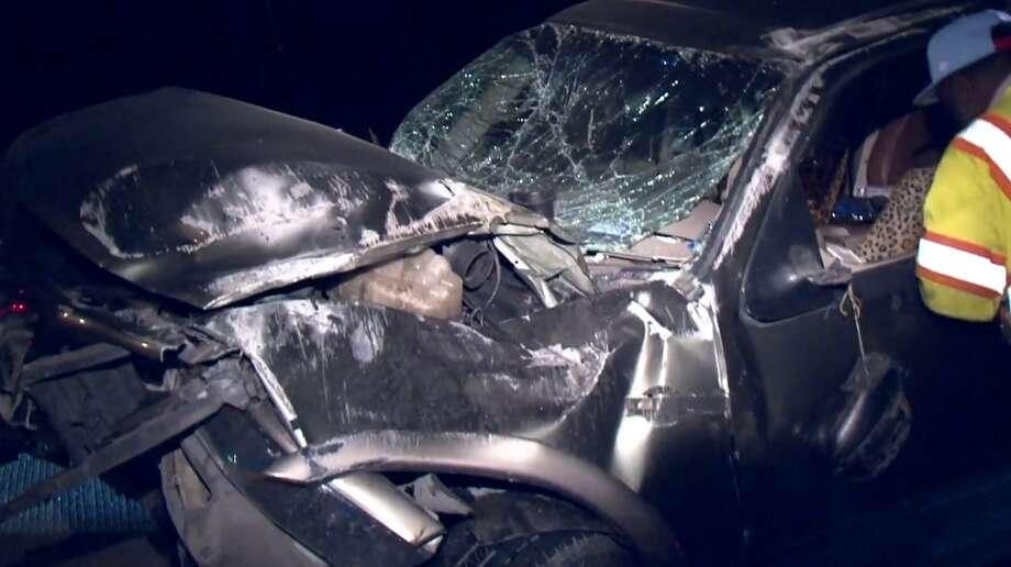 A blown tire likely caused a rollover crash late Monday that left three people hospitalized, including two children that were ejected from the vehicle, Houston police said. The crash was reported around 10:30 p.m. on Highway 90 near Wallisville. Photo: Metro Video