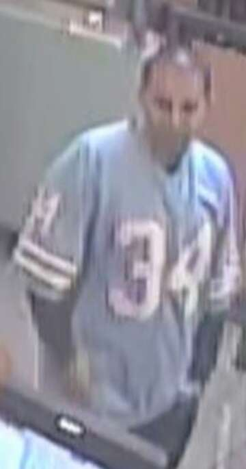 newest 2b6c2 d729f Suspect in Earl Campbell jersey robs east Houston Jack in ...