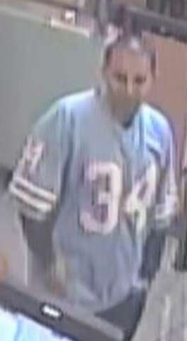 newest d4ff4 5869e Suspect in Earl Campbell jersey robs east Houston Jack in ...