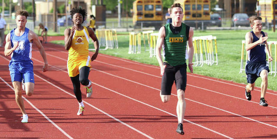 Metro-East Lutheran's Jack Bircher (middle right) approaches the finish of the 100 meters ahead of (from left) Marquette Catholic's Davion Simmons, EA-WR's Reggie Newtall and Father McGivney's Michael Hatley on Monday at the Prairie State Conference track meet in Wood River. Bircher won in a school-record time of 11.08 seconds. Photo: Greg Shashack/Hearst Illinois