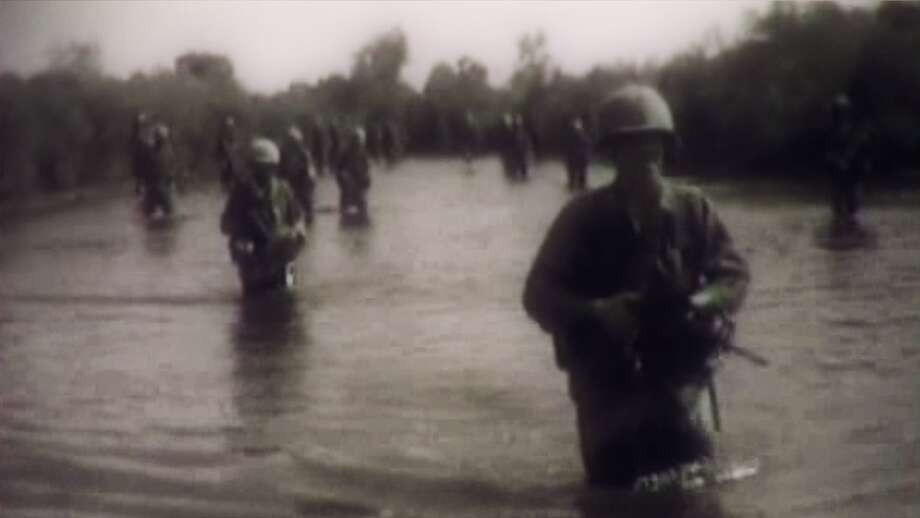 "Image of American soldiers crossing a river during the Vietnam, featured in ""The Mark of War,"" a new documentary about the enduring legacy of war. Photo: Courtesy Photo"