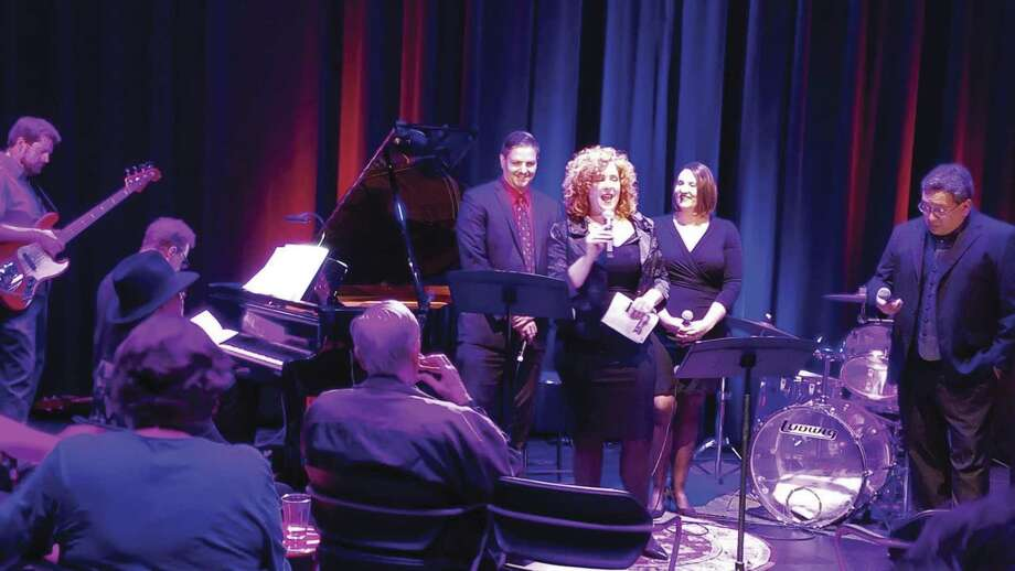 "Lone Star Lyric founder, Kelli Estes, welcomes the audience at MATCH Theater # 1 during a recent performance of LoneStarLyric's ""Another British Invasion."""