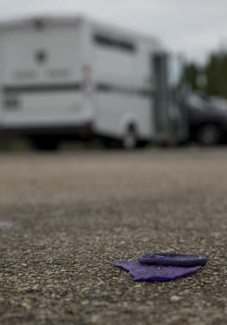 A discarded condom in the parking lot where Houston Police staged a daylight undercover operation on the Bissonnet Track. Photo: Godofredo A. Vásquez/Staff Photographer