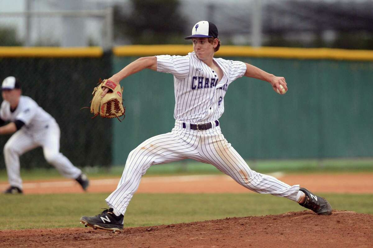 Dylan Theut (2) of Fulshear delivers a pitch during the second inning of a high school baseball game between the Fulshear Chargers and the El Campo Ricebirds on April 23, at Fulshear High School, Fulshear, TX.