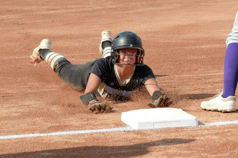 CiCi Mata (9) of Foster slides into third base during the first inning in Game 3 of a 5A-IV regional final playoff game between the Foster Falcons and the Angleton Wildcats on Saturday May 26, 2018 at the University of Houston, Houston, TX. Photo: Craig Moseley, Staff / Houston Chronicle / ©2018 Houston Chronicle