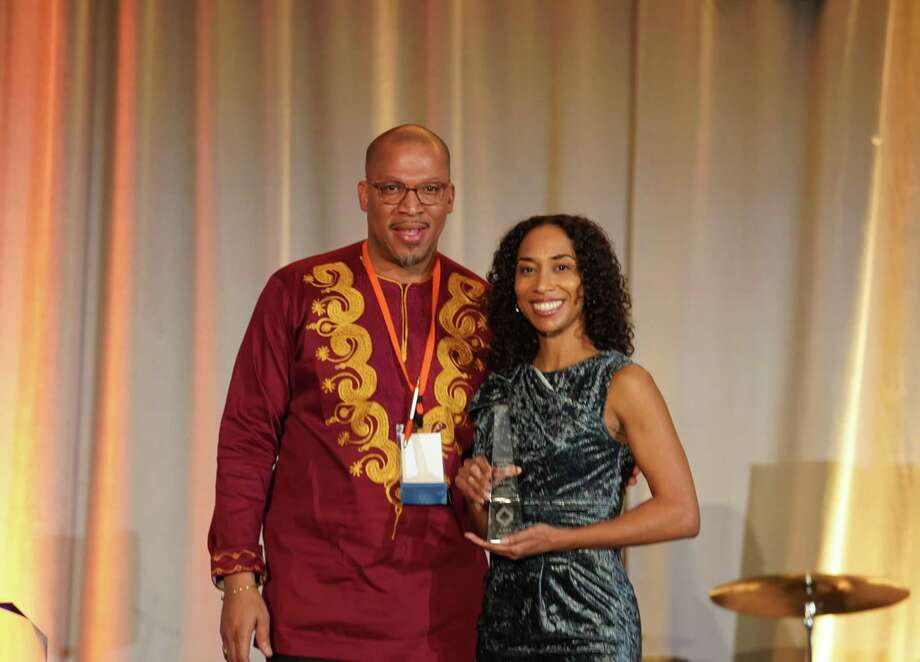 "Kara Straun, right, poses with AFBE's Vice President of Programs Edward Jones at the James A. Joseph Lecture & Awards Ceremony at ABFE's annual conference, this year titled ""HARAMBEE: Let's All Pull Together."" Photo: Contributed Photo"