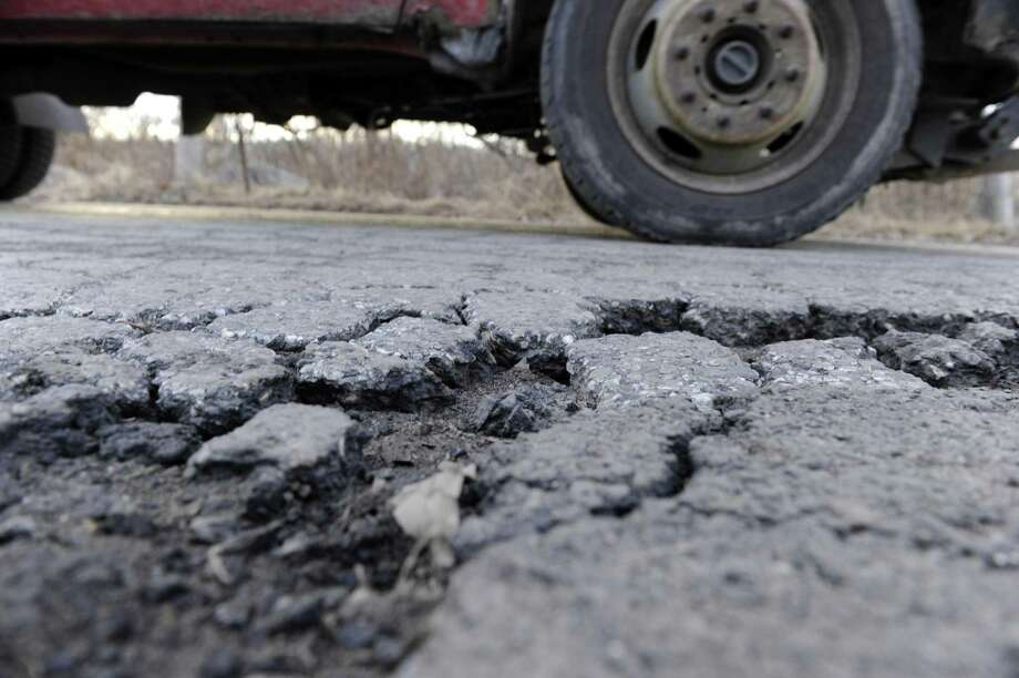 File photo of a pothole in New Milford. Photo: Carol Kaliff / Carol Kaliff / The News-Times