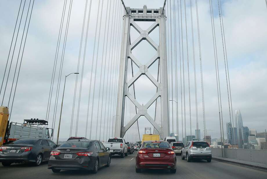 Westbound traffic on the Bay Bridge slowed to a crawl after three lanes were closed while Highway Patrol officers investigate a motorcycle accident in San Francisco, Calif. on Tuesday, April 30, 2019. It took some commuters over an hour to cross the bridge from the East Bay. Photo: Paul Chinn / The Chronicle