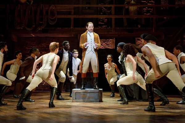 "Joseph Morales, center, plays Alexander Hamilton in the touring production of ""Hamilton"" that is coming to the Majestic Theatre."