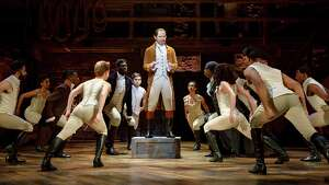 """Joseph Morales, center, plays Alexander Hamilton in the touring production of """"Hamilton"""" that is coming to the Majestic Theatre."""