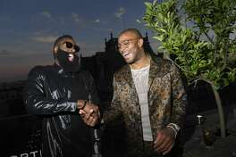 PARIS, FRANCE - JUNE 21: (L-R) James Harden and PJ Tucker attend the Cocktail Party for Mr Porter at Perchoir Du Marais as part of Paris Fashion Week on June 21, 2018 in Paris, France. (Photo by Victor Boyko/Getty Images For Mr Porter )