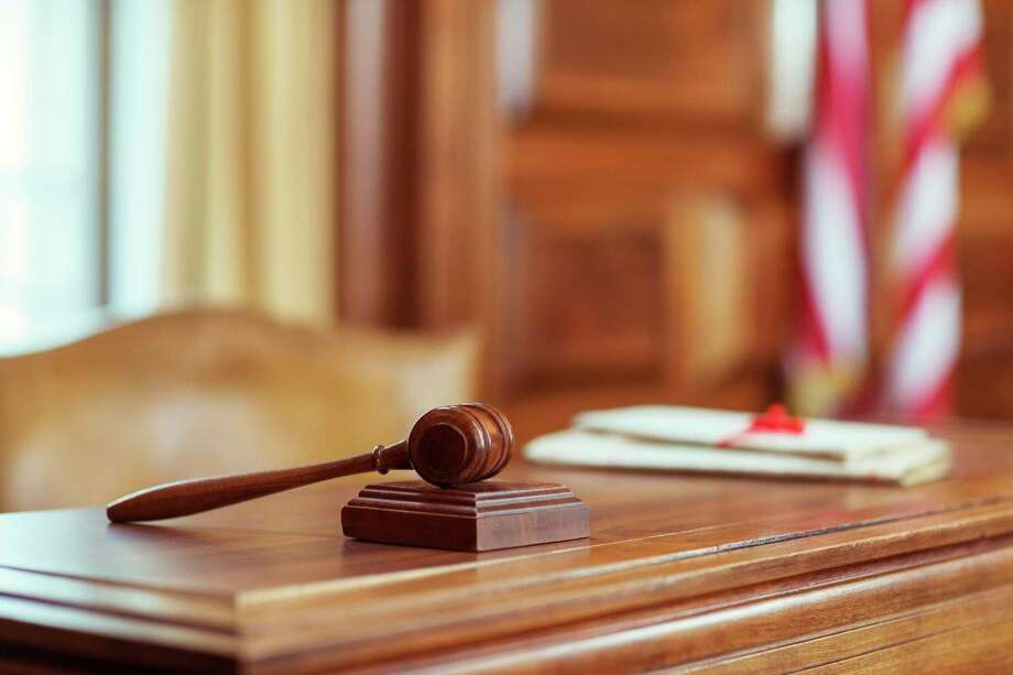 Gavel laying on judges bench in courtroom Photo: Getty Images / Getty Images / Caiaimage