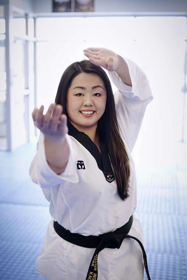 Yumi Kageyama, co-owner of Risen Taekwondo, poses for a photo at her business on Thursday, March 28, 2019, in Malta, N.Y. (Paul Buckowski/Times Union) Photo: Paul Buckowski / (Paul Buckowski/Times Union)