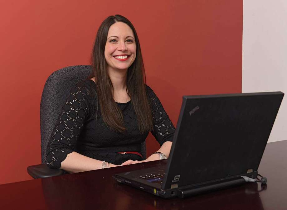 Ashley Jeffrey Bouck, executive director at Girls Incorporated of the Greater Capital Region, sits in her office in the newly renovated building at 80 Central Ave. on Friday, March 22, 2019 in Albany, N.Y. Girls Inc. of the Greater Capital Region, Lifepath (formerly Senior Services of Albany) and Northeastern Association of the Blind at Albany all share the building. (Lori Van Buren/Times Union) Photo: Lori Van Buren / 40046455A