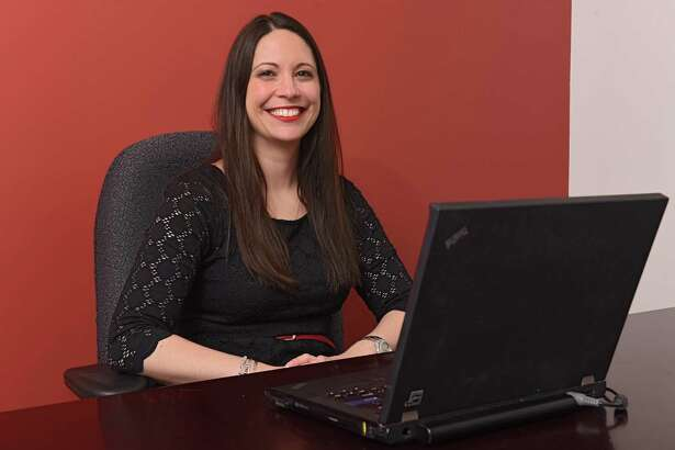 Ashley Jeffrey Bouck, executive director at Girls Incorporated of the Greater Capital Region, sits in her office in the newly renovated building at 80 Central Ave. on Friday, March 22, 2019 in Albany, N.Y. Girls Inc. of the Greater Capital Region, Lifepath (formerly Senior Services of Albany) and Northeastern Association of the Blind at Albany all share the building. (Lori Van Buren/Times Union)