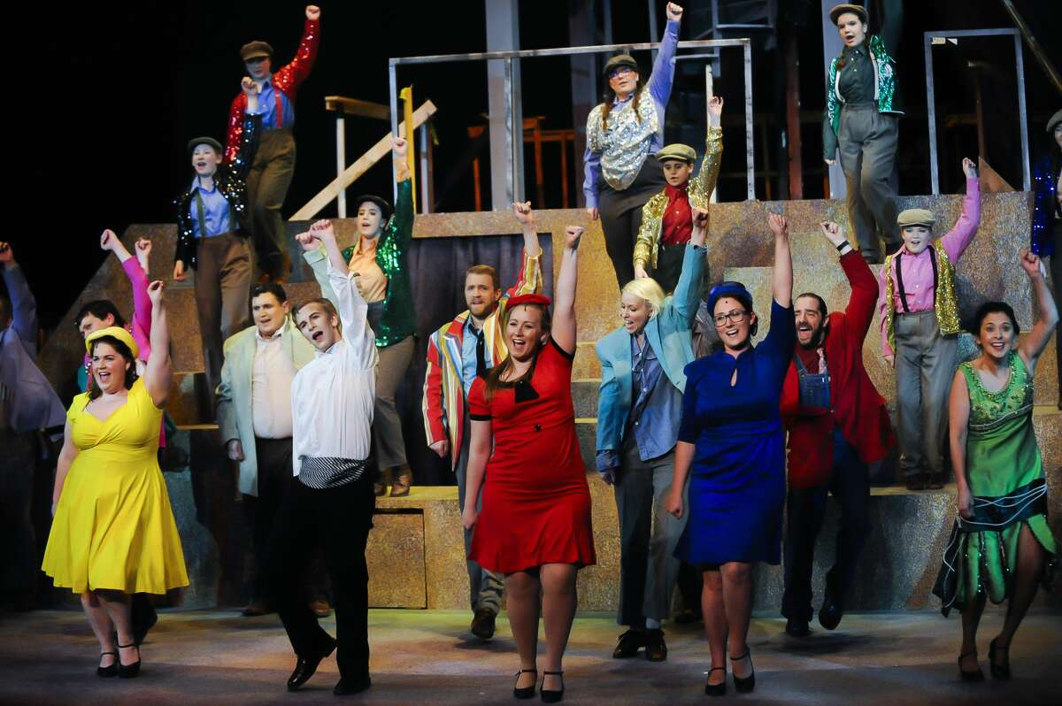 Actors perform a musical number during a dress rehearsal for Center Stage Theatre's production of