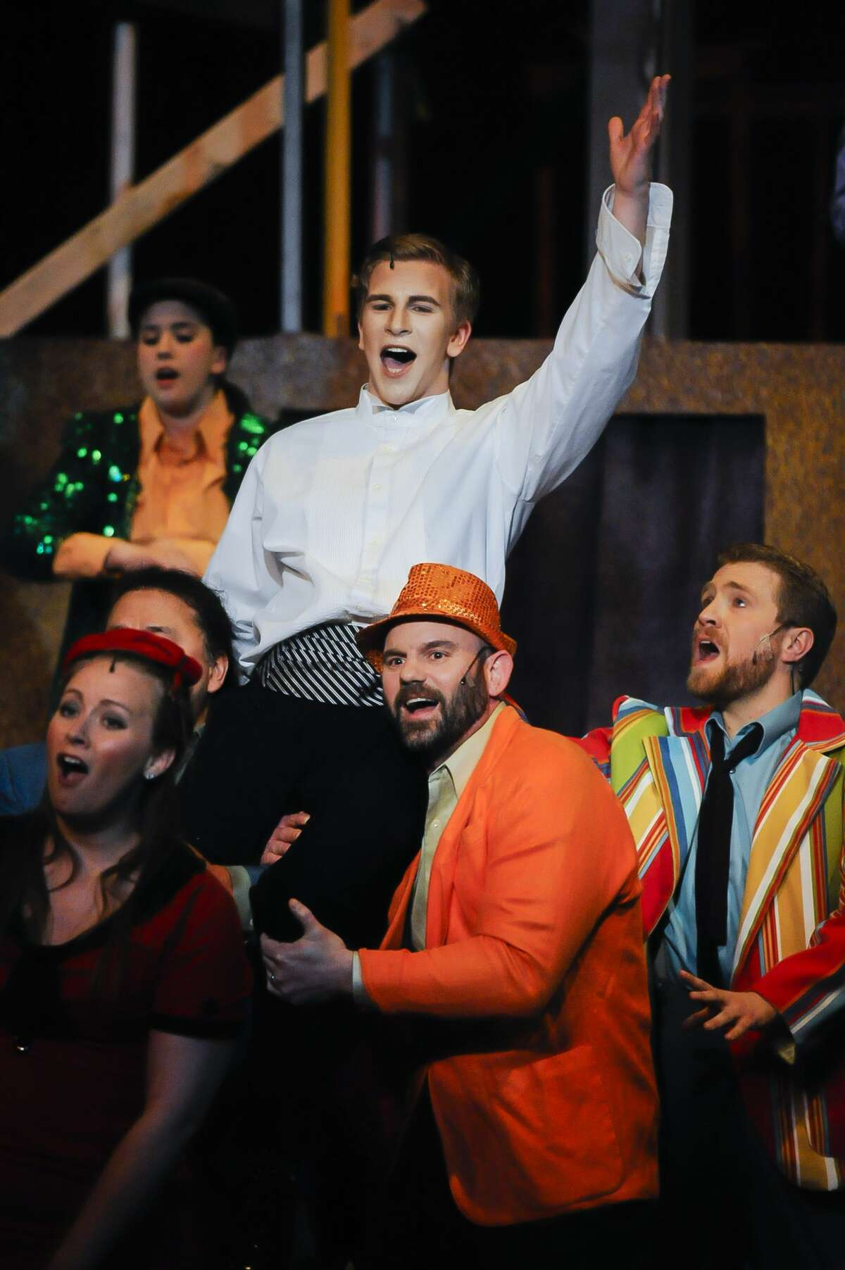 Nick Alfano, in the role of Joseph, center, performs a musical number alongside fellow cast members during a dress rehearsal for Center Stage Theatre's production of