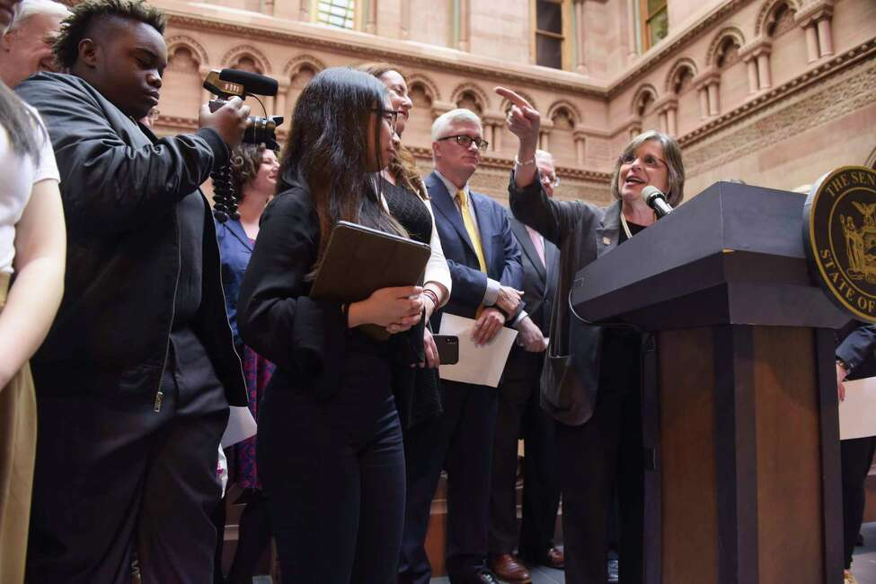 Assemblymember Donna Lupardo, at podium, the sponsor of the Student Journalist Free Speech Act in the Assembly, and Senator Brian Kavanagh, behind podium, the sponsor of the bill in the Senate, take part in a press conference at the Capitol with high school journalism students on Tuesday, April 30, 2019, in Albany, N.Y. Student journalists from six high schools around New York State gathered at the Capitol on Tuesday for Student Press Day. The students were there to push for passage of the Student Journalist Free Speech Act. (Paul Buckowski/Times Union)