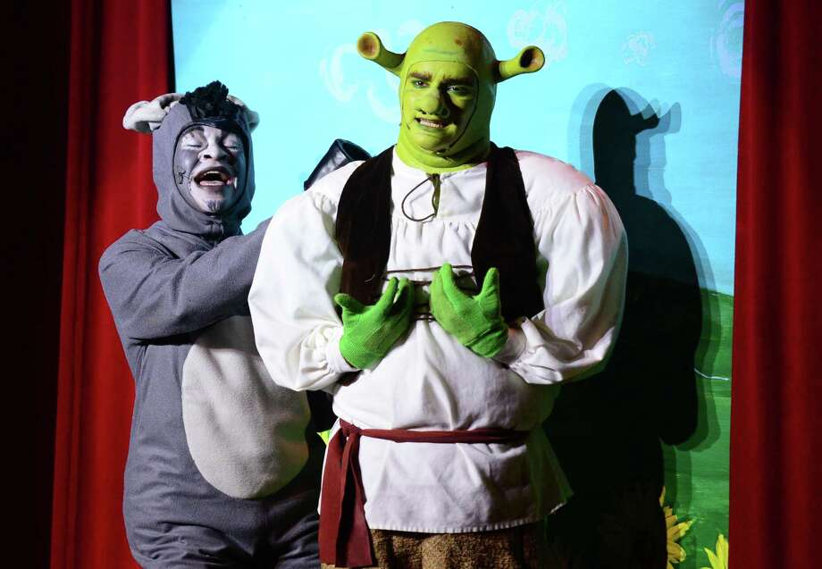The Norwalk High School drama students including Matthew O'Callhan as Shrek and Jason Iverson as Donkey perform the musical Shrek for middle school students Tuesday morning, April 30, 2019, in Norwalk, Conn. The show debuted April 26th with repeat performances this weekend Friday and Saturday at 7 p.m. and a Saturday matinee at 2 p.m. Photo: Erik Trautmann / Hearst Connecticut Media / Norwalk Hour