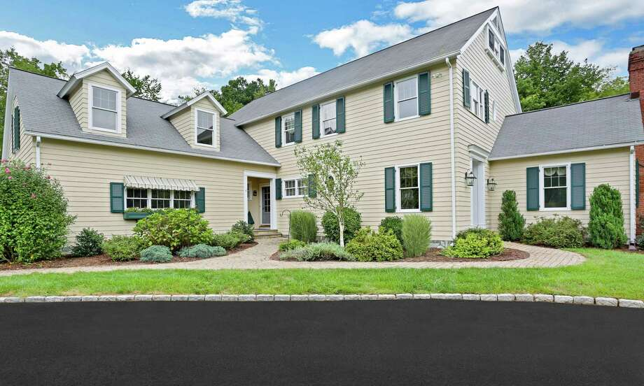 The colonial house at 48 Duck Pond Place is located in the Cannondale section of town within easy walking distance of Ambler Farm and the Rolling Hills Country Club and golf course.