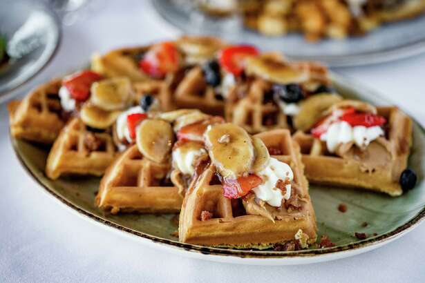 The Union Kitchen will open at The Boardwalk at Towne Lake, 9955 Barker Cypress, later this summer, replacing the former Jaxton's Grill House & Bar. Shown: Elvis Waffle (peanut butter, bacon and Bananas Foster sauce) on the menu at The Union Kitchen.