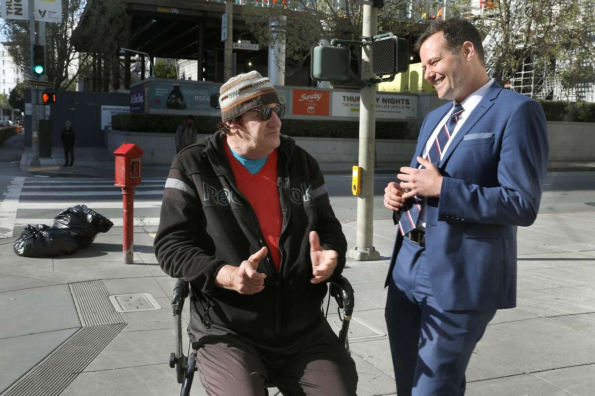 Scotty O'Farrell (left) talks with supervisor Matt Haney (right) about sidewalk conditions in the tenderloin on Wednesday, April 17, 2019, in San Francisco, Calif.