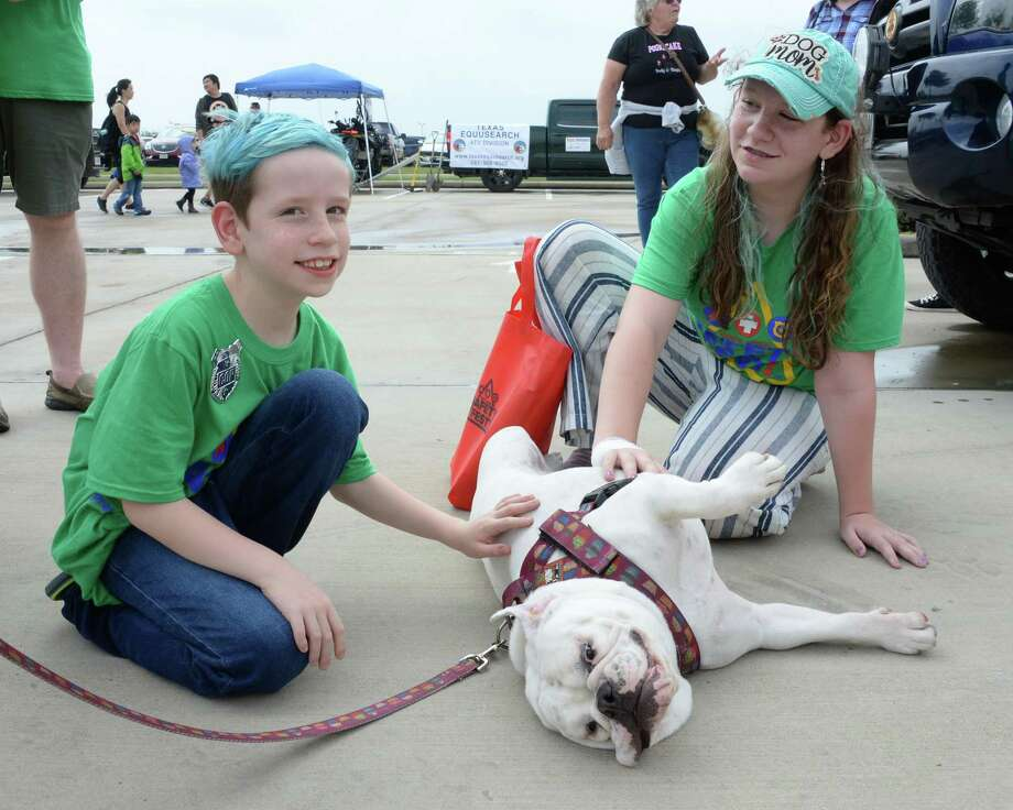 Poundcake, a rescue dog with the Frank's Way Foundation gets attention from Makayla Graf, right, and brother Jackson during the Katy Area Safety Fest in Katy, TX on Saturday, April 13, 2019. Photo: Craig Moseley, Houston Chronicle / Staff Photographer / ©2019 Houston Chronicle