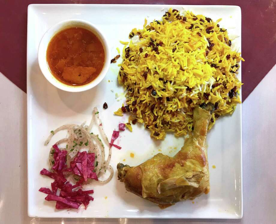 Zereshk polo at Saffron Persian Cuisine is dish of saffron-stained chicken and rice cooked with barberries. Photo: Paul Stephen / Staff