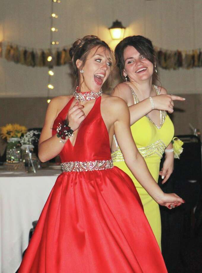 Harbor Beach students Brooklyn Karg, left, and Madison Roggenbuck show off their dancing skills Saturday night at Harbor Beach's prom celebration. For more photos of the night, see Page 8A. (Bradley Massman/Huron Daily Tribune)