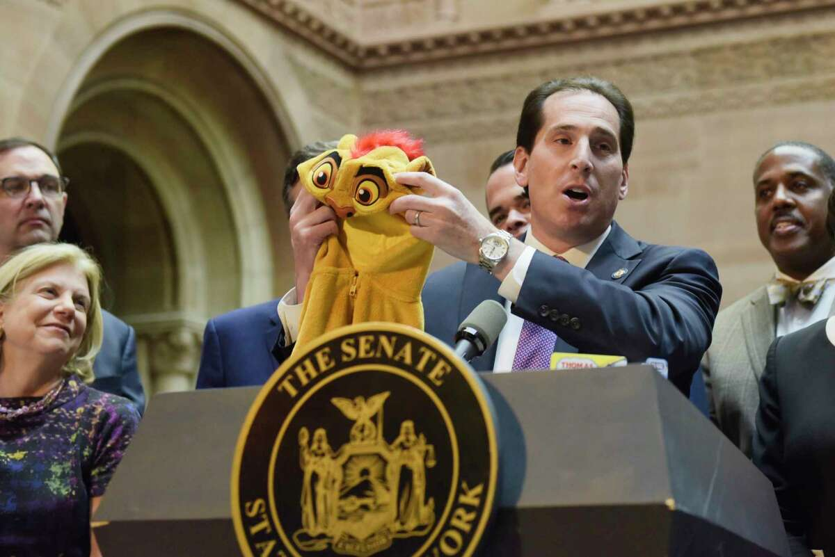 Senator Todd Kaminsky holds up a Lion king costume that has a zipper on it made of cadmium during a press event held by the New York State Senate majority at the Capitol on Tuesday, April 30, 2019, in Albany, N.Y. The Senate majority held the event to talk about their legislation to protect New Yorkers against toxic materials, establish a Constitutional right to clean air and water, and to protect the state?•s environment and natural resources. (Paul Buckowski/Times Union)