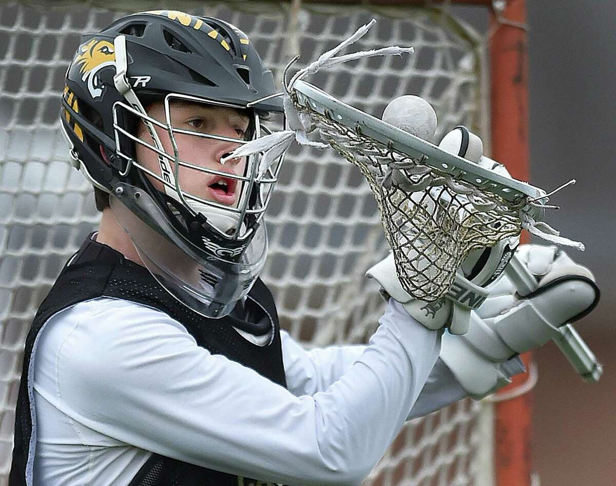 Hand goalie, Griffin Fitzmaurice, warms up Thursday, March 29, 2018, before a scrimmage.