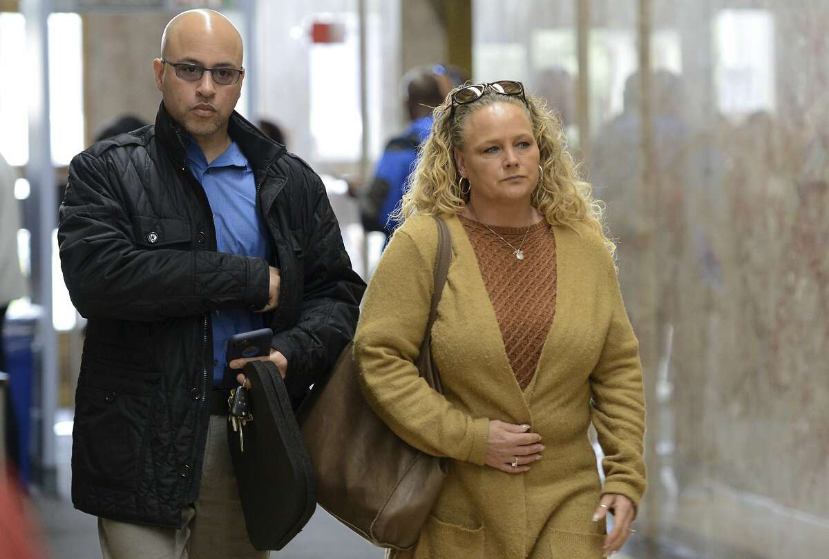 David and Kimberly Gregory, parents of Michela Gregory, a victim in the 2016 Oakland warehouse fire, arrive at Ren� C. Davidson Alameda County Courthouse in Oakland, Calif., Tuesday April, 30, 2019. Derick Almena and Max Harris are standing trial on charges of involuntary manslaughter after the 2016 fire killed 36 people at the warehouse party in Oakland. (AP Photo/Cody Glenn)