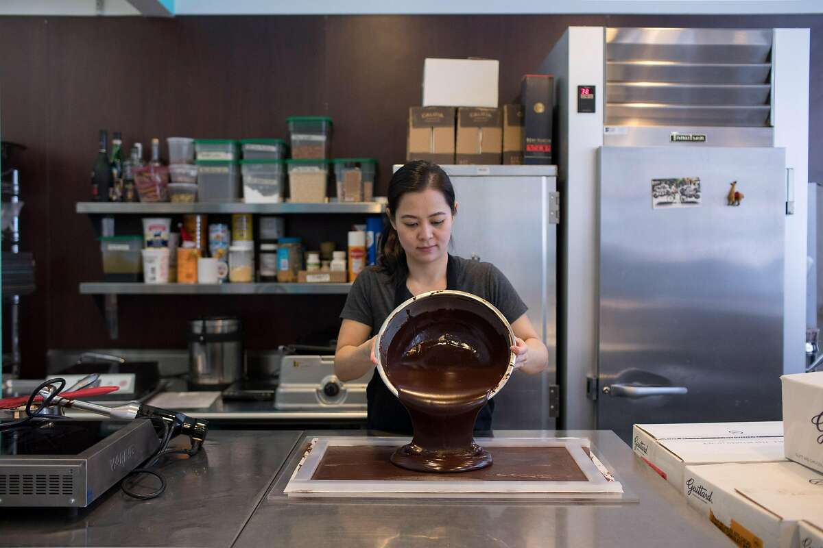 Chef and owner Wendy Lieu pours the chocolate and caramel mixture into a mold for cooling before using a confectionary guitar cutter to cut the pieces uniformly at S�c�la Chocolatier in San Francisco, Calif. on Thursday, February 28, 2019.