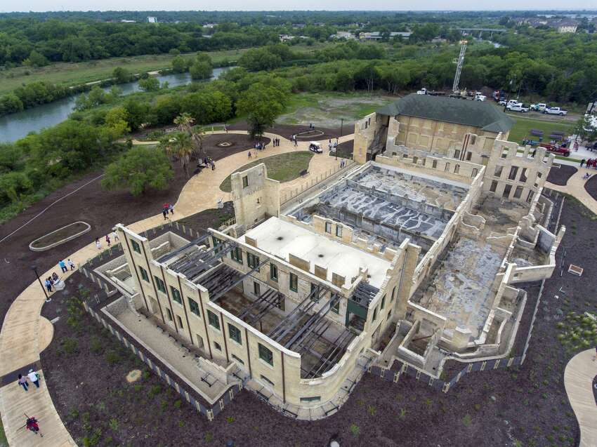 The former Hot Wells Hotel is seen Tuesday, April 30, 2019, during the grand opening of the Hot Wells of Bexar County park. The once-crumbling building has been stabilized by Bexar County as part of turning the approximately four acre site into a park which is connected to the Mission Reach section of the San Antonio River Walk.