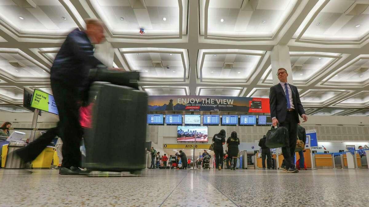 Travelers make their way through Terminal A at Bush Intercontinental Airport Tuesday, Jan. 15, 2019, in Houston.