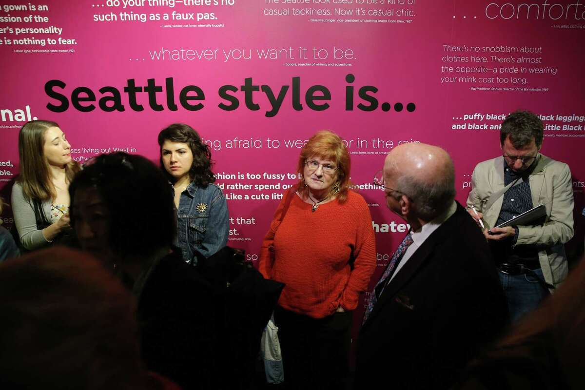 People listen to curator Clara Berg during a media preview tour through the new Seattle Style: Fashion/Function exhbit at MOHAI, which will be open to the public May 4-Oct. 14. From grunge to high fashion, the exhibit features garments that have defined the styles of the region from the mid-1800s to the present.