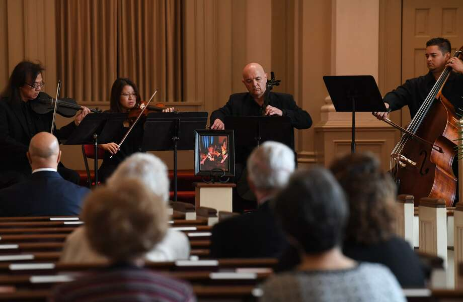 From left, Hubert Cheng, Grace Anderson, Thomas Schroeder and Billy O'Keefe perform Tuesday during a special service for Yu Zhou Gu who died while playing violin at the Symphony of Southeast Texas' April show. The memorial was held at Calder Baptist Church in Beaumont.   Photo taken Tuesday, 4/30/19 Photo: Guiseppe Barranco/The Enterprise, Photo Editor / Guiseppe Barranco ©