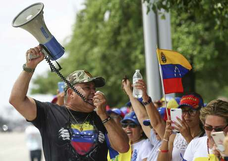 """Jose Criollo, 61, leads a chant in protest of current president Nicolás Maduro Tuesday, April 30, 2019, in Houston. Venezuelans in Houston assembled to support Juan Guaidó, Venezuela's opposition leader, who declared on Tuesday that they are """"beginning the final phase of Operation Freedom."""" Guaidó called for a march inside Venezuela and abroad for May 1st, but that was changed for today once Leopoldo Lopez, an opposition leader, was released from prison."""
